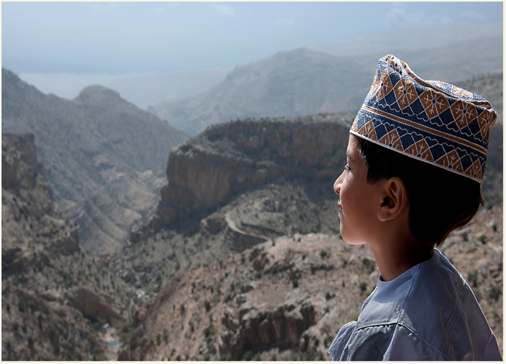 A young Omani boy marvels at a magnificent mountain view