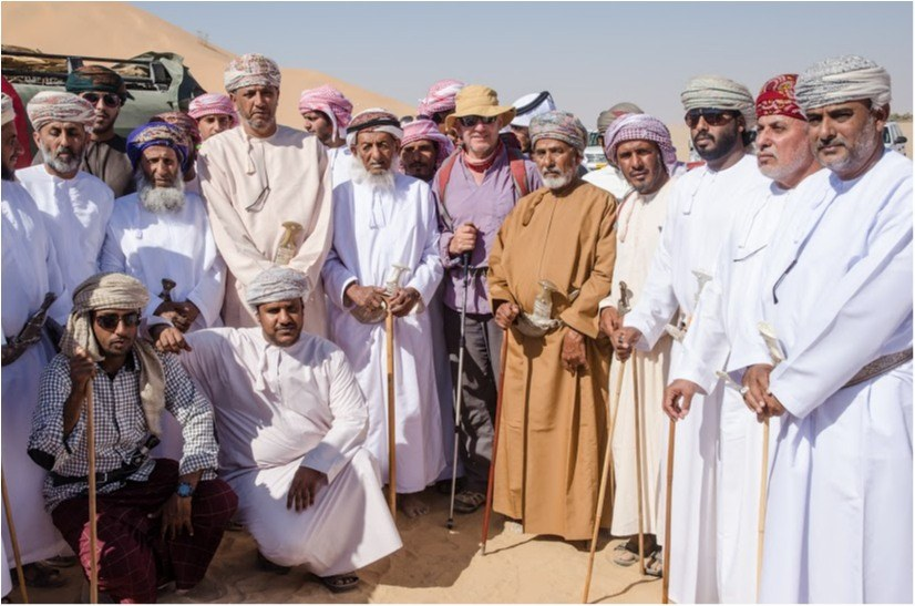 Mark Evans (centre) receives a warm greeting during the Empty Quarter desert trek